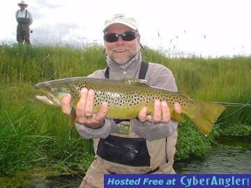 Capt rick grassett with a stone creek hopper fly brown for Beaverhead fishing report
