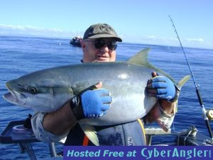 Paul Justin with a fat kingfish caught jigging in New Zealand