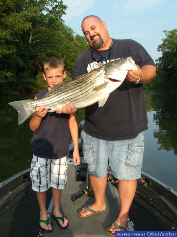 Father and Son With Big, Alabama Striped Bass!