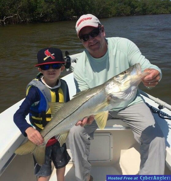 Youth angler with nice snook with Capt. Todd Geroy