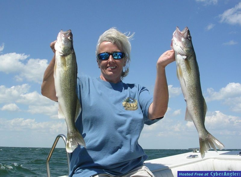 Heidi is a pleased with her Lake Erie walleye charter fishing adventure