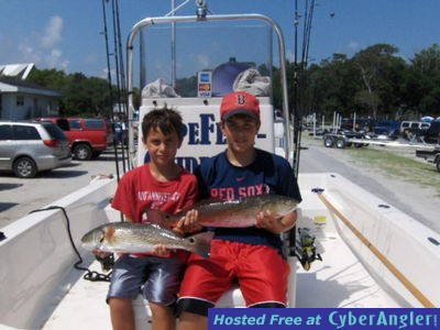 Brothers catching Red Drum