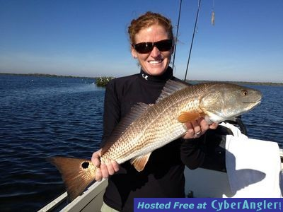 Sarah with a nice redfish she caught while fishing with Capt. Joe Porcelli