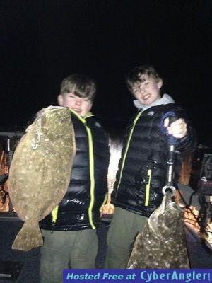 Kids gigging flounder