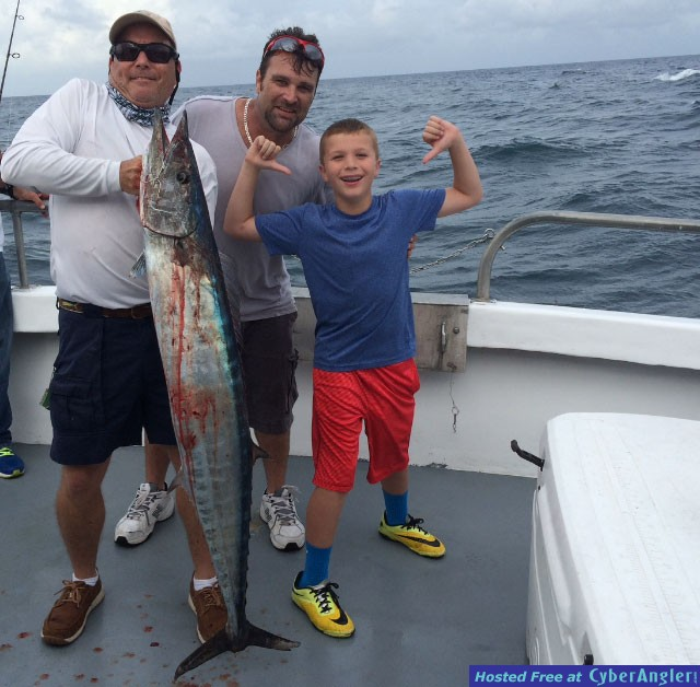 Nine-year-old Kaden MacNeil with 40 lb. Wahoo.