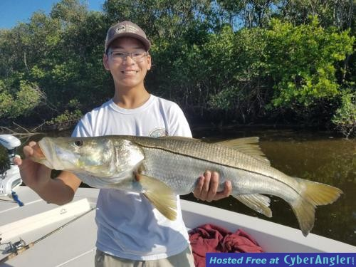 Joey_with_big_snook_caught_on_a_safety_harbor_Fishing_charter