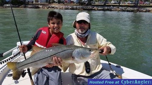"9 yr old. caught a 36"" 15lb snook with mytarpon.com"