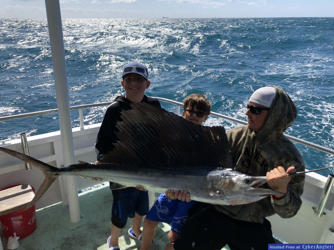 kids with sailfish